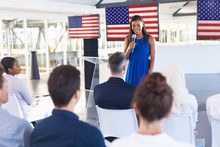 Female Speaker Speaks In A Business Seminar