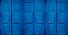Mediterranean Style Style Blue Window Sun Or Storm Shutters Closed. Background Concept.