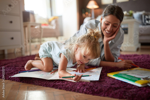 Obraz Adorable kid with female drawing indoor - fototapety do salonu