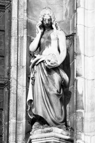 Poster Bestsellers Saint Mary Magdalene of Milan Cathedral facade. Black and white vintage style.