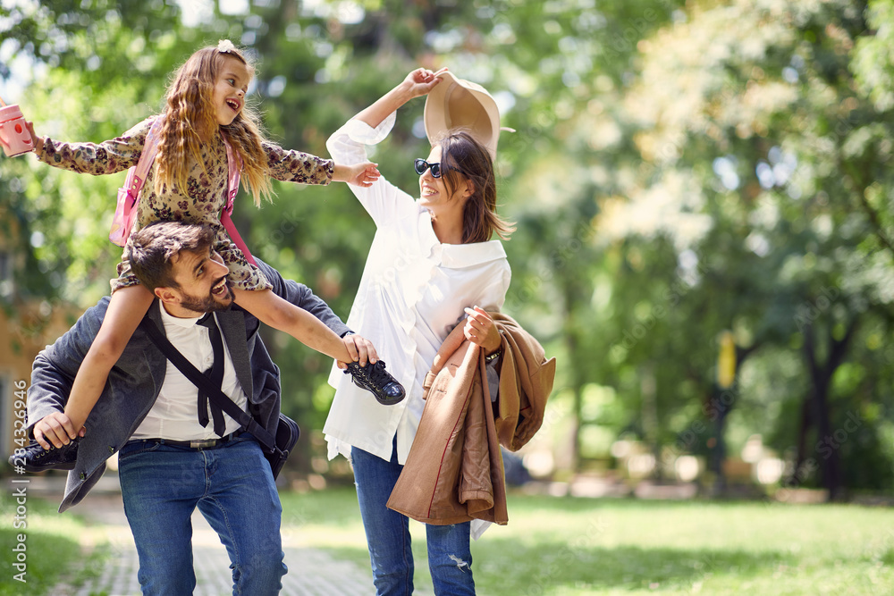 Fototapety, obrazy: family having fun in park after school