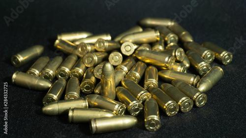 Canvas Print Yellow Gun Bullets On Black Background