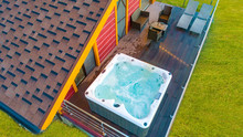 Hot Tub In The Country House. A Hydromassage Pool Is Located On The Terrace. Whirlpool Bath On The Balcony Top View. SPA Treatments. Water Treatments On The Balcony Of The House. Hydromassage.