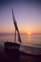 Mozambique: Bazaruto Archipelago, Benguerra Island, Local Fishing Boat, Sunset.