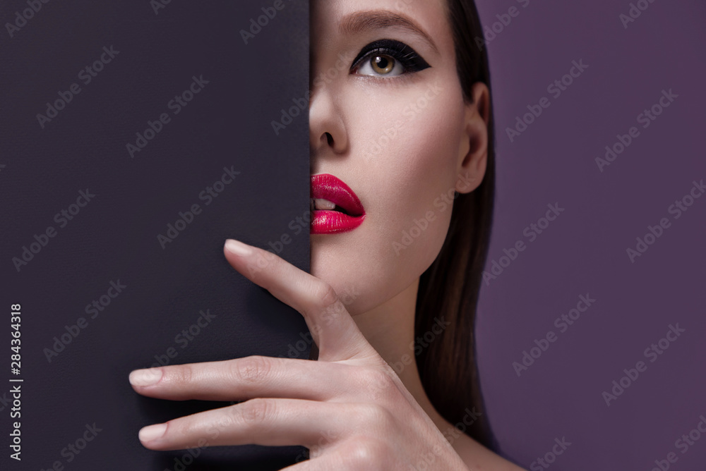 Fototapety, obrazy: High fashion, glamour beauty portrait of beautiful caucasian young woman model with bright makeup. Perfect clean skin with red lips. Conceptual. Half face