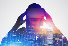 Astonished Woman In VR Glasses In Night City