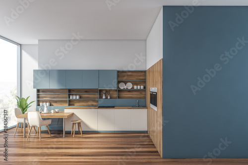 Foto Blue and wooden kitchen with mock up wall