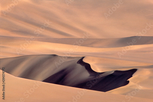 Asia, China, Dunhuang. These immense sand dunes are a popular tourist attraction at Dunhuang in Gansu Province, China. - 284374392