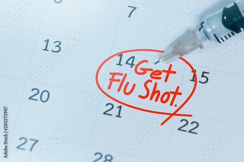 Valokuvatapetti Get Flu shot text on calendar and syringe,influenza background concept