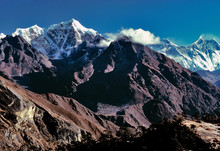 Asia, Nepal, Sagarmatha NP. Tawache Peak, Left Of Center, And Mt. Everest, Lhotse And Nuptse To The Right Of The Cloud Bank, Straddle The Nepal-Tibet Border.