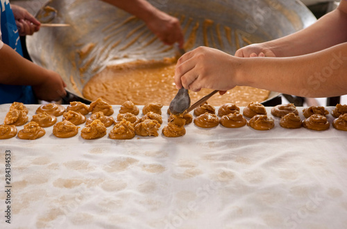 Ko Samui, Thailand - Thai citizens make traditional sugar cane sweets.