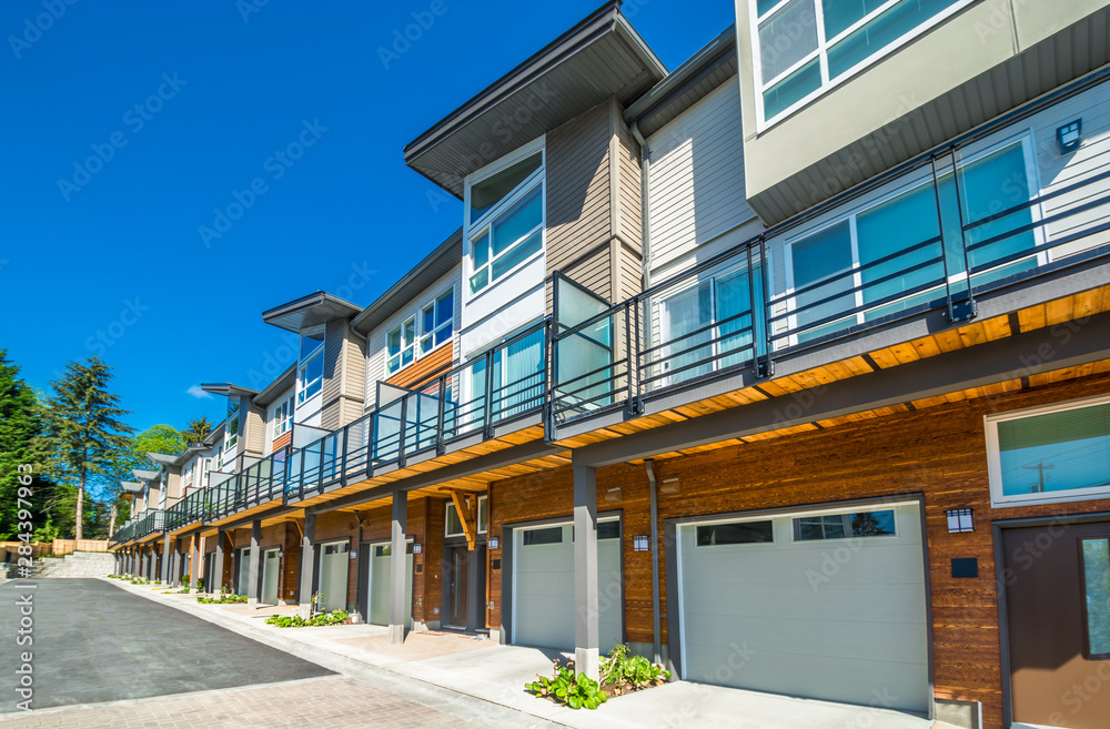 Fototapety, obrazy: Row of brand new townhouses on sunny day.