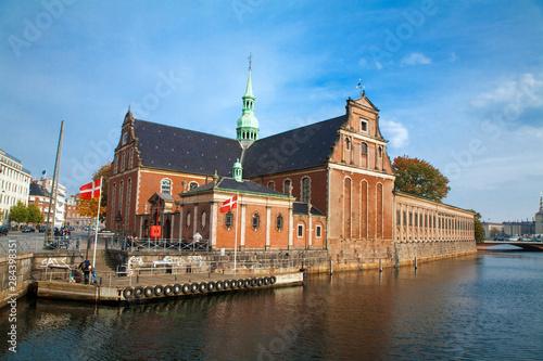 Photo  Copenhagen, Denmark - A canal running through an old world city.