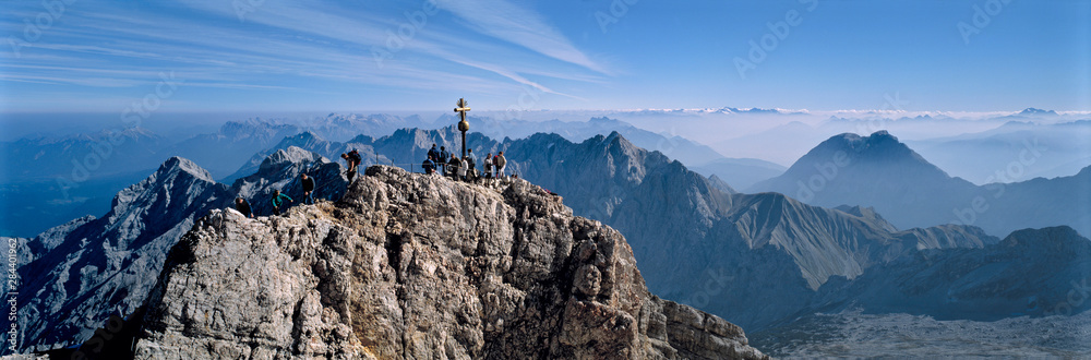 Fototapety, obrazy: Germany, Bavaria, Zugspitze. Hikers enjoy an inspiring view to the Tirol from the Zugspitze summit in Bavaria, Germany.