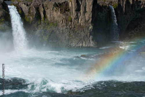 Recess Fitting Waterfalls Iceland, Myvatn District off the Ring Road, Northeast Region. Skjalfandafljot River, Godafoss waterfall with rainbow, the most popular waterfall in Iceland.