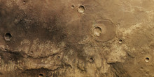 Close-up Shot Of The Yellow Moon With Craters On The Surface.Texture Or Background