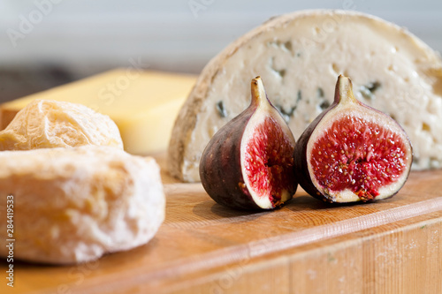 Stockholm, Sweden - Closeup image of cheese, a fig, and other food on a countertop.