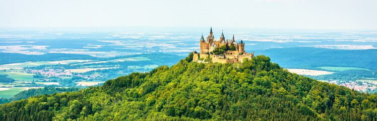Hohenzollern Castle on mountain top, Germany. Panoramic view of Burg Hohenzollern in summer. This castle is famous landmark in vicinity of Stuttgart. Landscape of Swabian Alps with Gothic castle.
