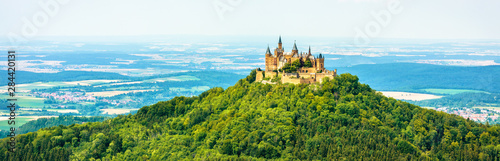 Fototapeta Hohenzollern Castle on mountain top, Germany. This castle is a famous landmark in vicinity of Stuttgart. Panoramic view of Burg Hohenzollern in summer. Landscape of Swabian Alps with Gothic castle. obraz