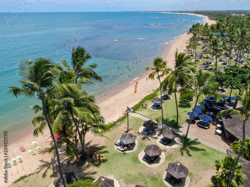 In de dag Mexico Aerial view of tropical white sand beach, palm trees, umbrellas and turquoise clear sea water in Praia do Forte, Bahia, Brazil. Travel tropical destination in Brazil