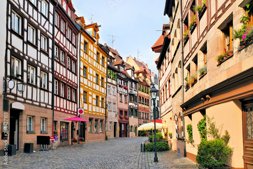 Fényképezés Beautiful street of half timbered houses in the Old Town of Nuremberg, Bavaria,