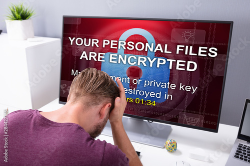 Fototapeta  Worried Man At Computer With Ransomware On The Screen