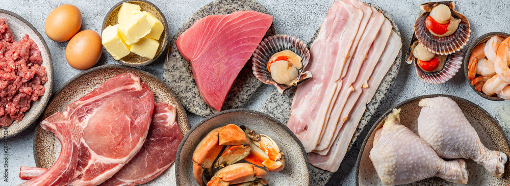 Fototapeta Selection food for CARNIVORE DIET. Seafood, Meat, megs and fat. Zero carbs diet concept