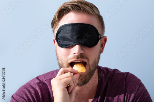 Blindfolded Man Testing Food Canvas Print