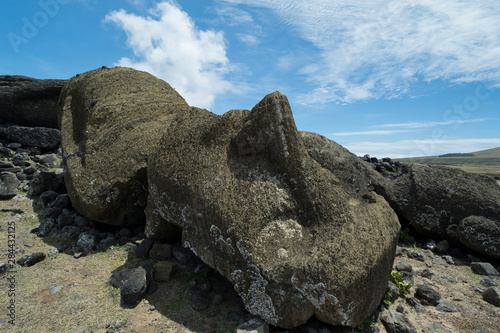 Fotobehang Historisch geb. Chile, Easter Island aka Rapa Nui. Historic unrestored moai site of Ahu One Makihi located near Rano Raraku. Toppled moai statues on volcanic rock ahu (altar).