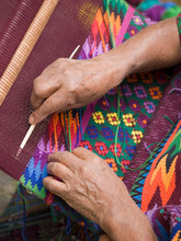 Antigua, Guatemala. A Weaver In Indigenouos Dress At Work.