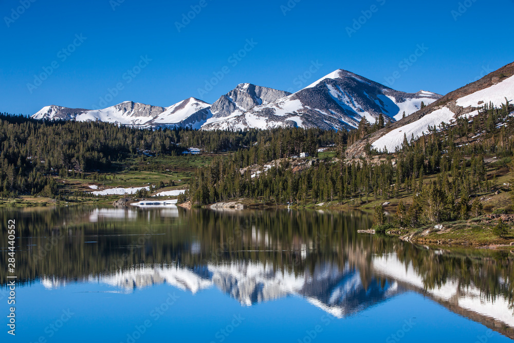 Yosemite National Park. The Kuna Crest and Mammoth reflections in Tioga Lake.