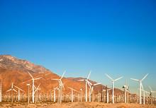 Palm Springs, CA, USA. Wind Turbine Farm In The Desert Under A Clear Blue Sky.