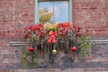Usa, Georgia, Savannah, Christmas Decorations In Window Of Historic Building In Downtown Savannah.