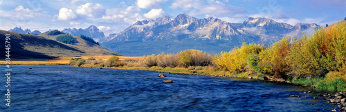 USA, Idaho, Sawtooth NRA. The Salmon River courses wide and azure before the rugged Sawtooth range in Sawtooth NRA, Idaho.