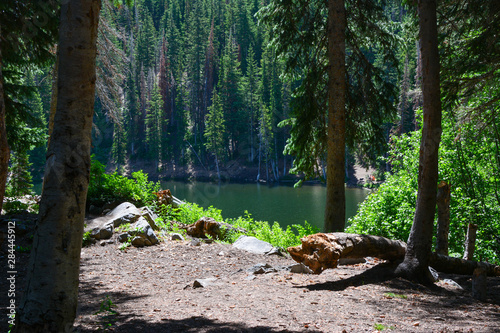 Camping spot along a rocky mountain alpine lake