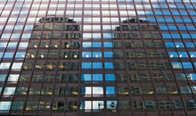 USA, Illinois, Chicago. Skyscrapers Reflect In The Windows Of Another Skyscraper.