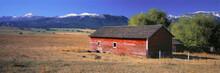 USA, Oregon, Wallowa Mountains. Red Barn Near Joseph In The Wallowa Mountains In Oregon