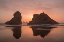 USA, Oregon, Bandon Beach. Sea Stacks Silhouetted At Sunset.