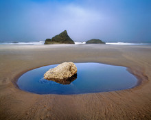 USA, Oregon, Face Rock Wayside. Fog Hovers Over Face Rock Wayside, Bandon, Oregon.