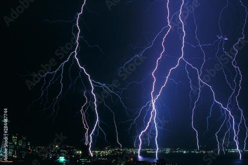 Photo Multiple lightning strikes on Elliott Bay, Seattle, Washington State, USA