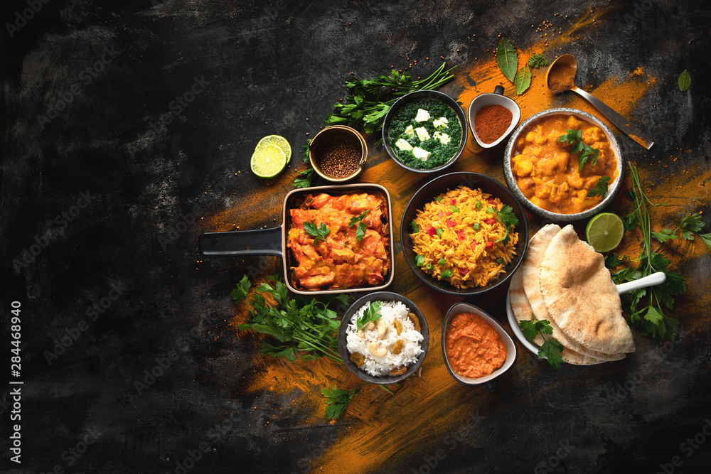 Fototapety, obrazy: Assorted indian food on black background..