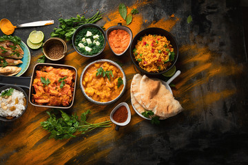Assorted indian food on black background..