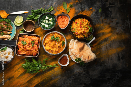 Fotobehang Eten Assorted indian food on black background..