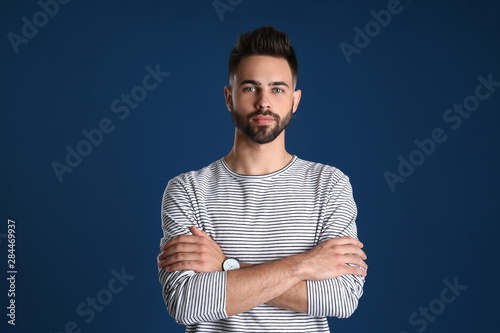 Portrait of handsome young man on color background