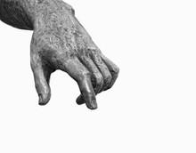 Hand. Fragment Of Ancient Sculpture. Antique Sculpture Arm On White Background. Sculpture Statue Hand Extended Points Down. White-black Color. Copy Space.