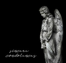 """Stone Memorial Grieving Angel Statue On Black Background. Condolence, Mourning Cards Or Obituary. Inscription """"sincere Condolences"""". Soft Focus"""