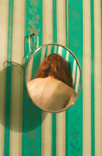 Back Of Redhead Woman Reflected In Mirror