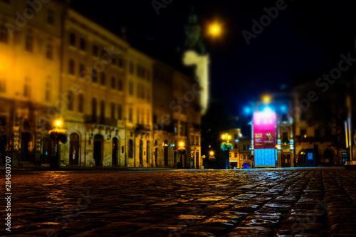 Fotomural  Illuminated street of old european town at night