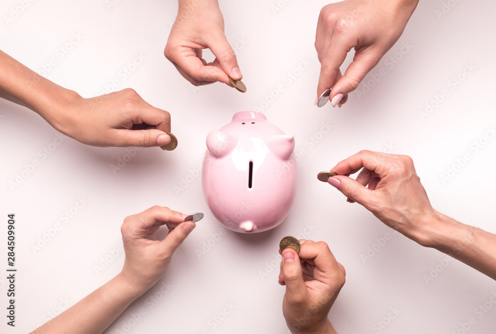 Fototapety, obrazy: People hands throwing coins in piggy bank for crowdfunding