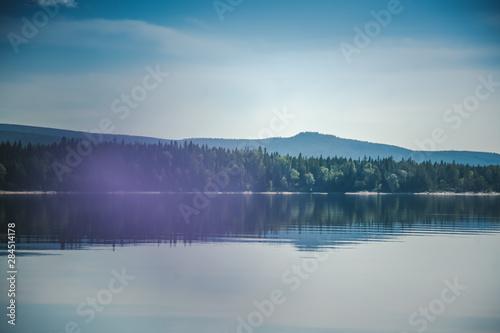 Aluminium Prints Dark grey Beautiful summer landscape, the shore of Lake Snasa in Norway, soft focus through the flowers
